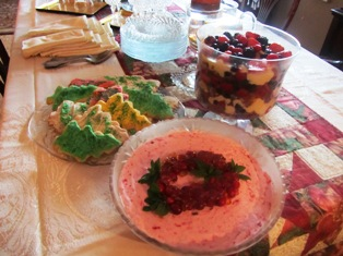 Frozen cranberry souffle (foreground), cookies, trifle