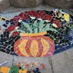 Pique assiette mosaic adorns this garden step