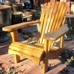 Classic Adirondack Adirondack chair, surely created for the enjoyment of a a garden