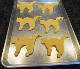 A tray of cat-shaped cookies will bake for 7-10 minutes at 400 degrees Fahrenheit
