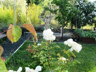 The roses, bench, angel, and fruit trees provide a lovely setting to view the mountain peaks
