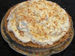 The coconut cream pie piled high with whipped cream and toasted coconut is always a hit for Christmas dessert