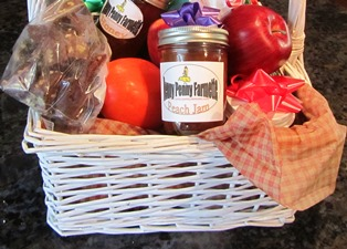 The baskets are filled with fudge, jams, honey, fresh fruit, and other treats