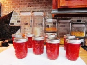 Jars of blood orange marmalade in a festive red currant color