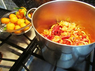 A large pot and a wooden spoon work well for cooking the marmalade