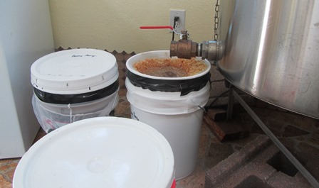 Honey streaming from the spigot of the electric power-driven centrifugal force spinner