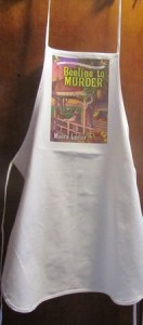 I wore an apron bearing my book cover while I helped stuff bags with lavender and rosemary