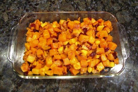 Cubes of butternut squash with dried cranberries and cinnamon-spiced almonds