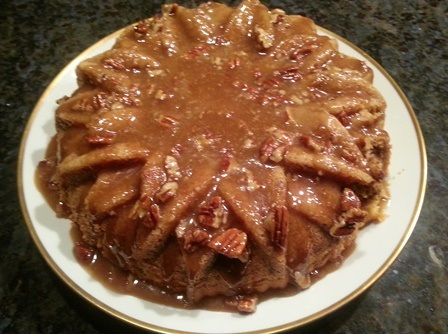 The praline icing drizzled over the top tastes great but diminishes the contours lines of the sunflower petals