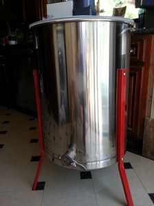 This electric honey extractor holds four frames; honey is spun out through centrifugal force