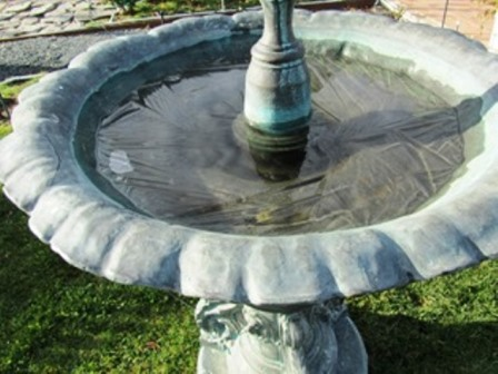 The fountain water has frozen overnight and awaits to sun to melt