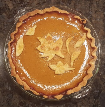 Our pumpkin pies feature leaves made from pie dough, brushed with egg, and sprinkled with sugar before baking